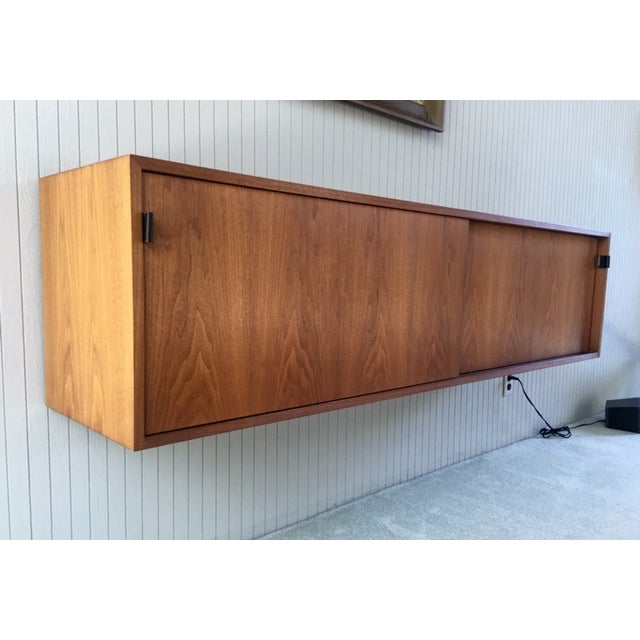 A stunning rare Florence Knoll floating credenza sideboard. All original in excellent condition. Original Knoll label...