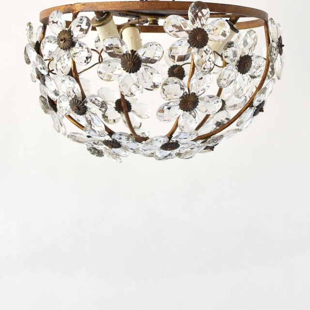 Beautiful vintage Italian flush mount light fixture adorned with clear crystals in a daisey pattern. The metal frame has a...