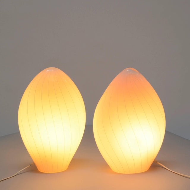 An excellent pair of Vetri Murano translucent white table lamps in perfect condition. Featuring a handblown spiral swirled...