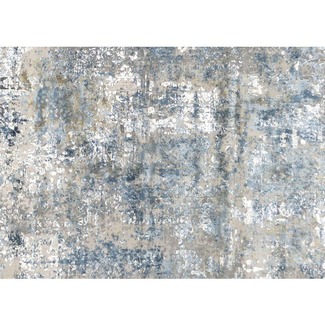 Contemporary Turkish Loomed Rug. Made with Viscose an Bamboo silk in a transitional abstract designs. With over 2.000.000...