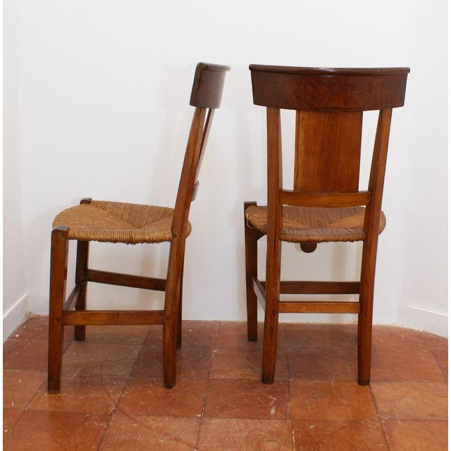 A pair of Italian painted tole and gilt fruitwood chairs, early 19th Century. Priced as pairs. Three pairs available with...