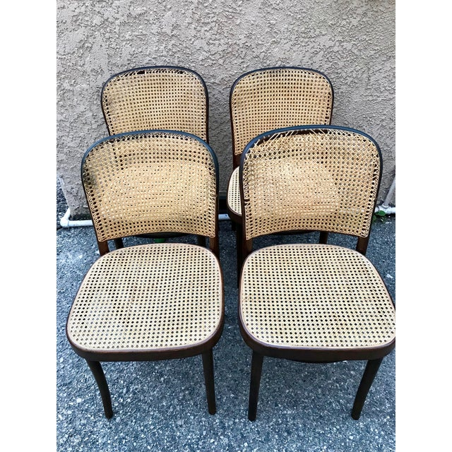 Set of 4 armless Thonet Bistro chairs with caned seat and backrest. Rich espresso brown bentwood finish. Handmade in...