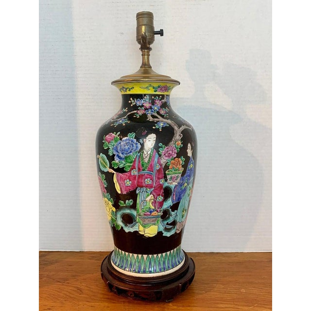 Japanese Vase with Black Background in the Style of Chinese Famille Verte. Well decorated with woman in a garden. No...