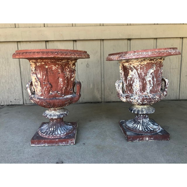 These are a pair of Neo Classical Italian urns. The Medici Urn was one of the most popularly reproduced antiquities and...