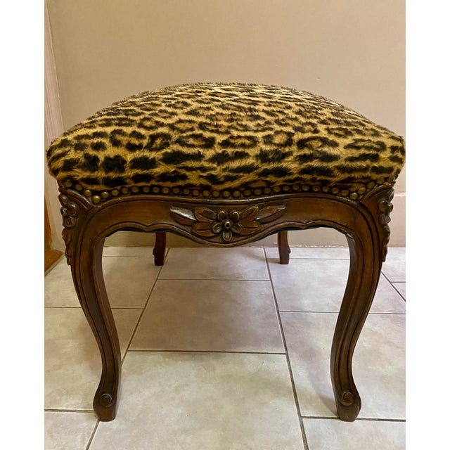 Ottoman in leopard with a vintage lacquered wooden design. Great look in the living or bedroom.