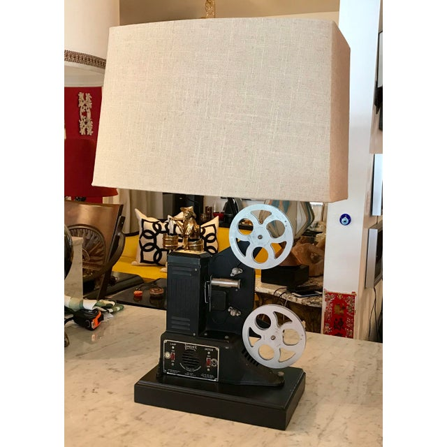 This is a very cool custom-made table lamp, made from a vintage movie projector. It is a great conversation piece and a...