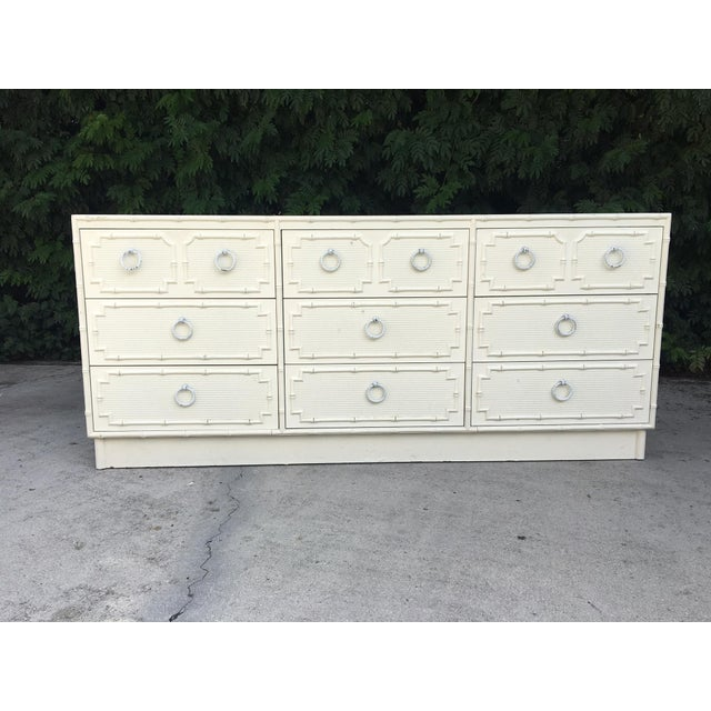 9-drawer dresser in faux bamboo by Omega Furniture features original hardware and faux rattan-front drawers. Excellent...