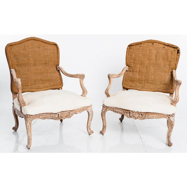 The pair of antique French Louis XV chairs are Ca. 1860's. They are very generous size for the time period. Horsehair fill...