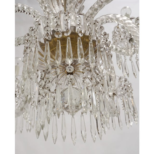 An exquisite, 1930's, French, 10-light chandelier; made of all glass and crystal undulating, rope arms, gadrooned...