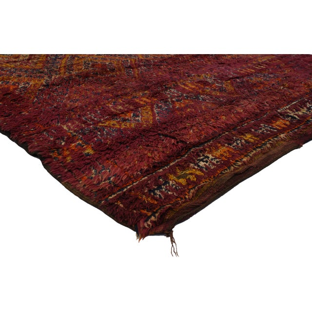 Saturated with good taste and a lively attitude, this vintage Berber Moroccan rug features modern style. It is swathed in...