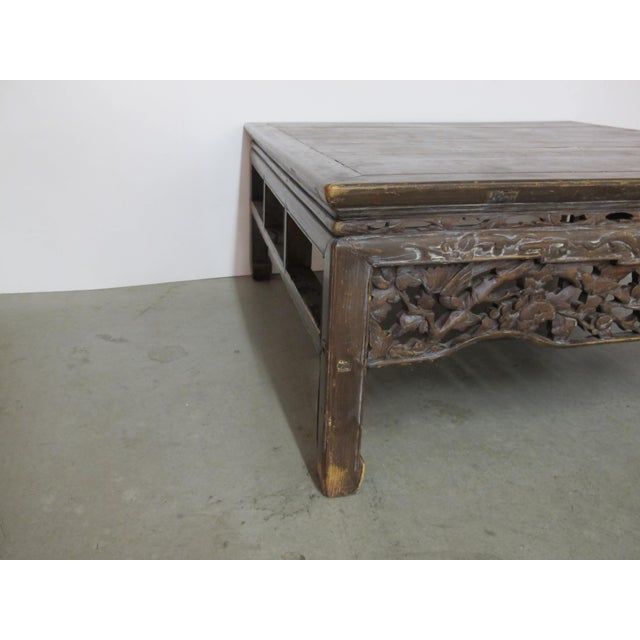 This coffee table shows patina( See photo's) I am not sure of its age or its history. It is made of all wood and is...
