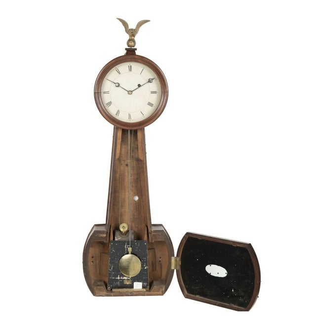 For sale is a rare weight driven banjo clock. This clock features a wooden case, glass panels, and an 8 day movement. The...