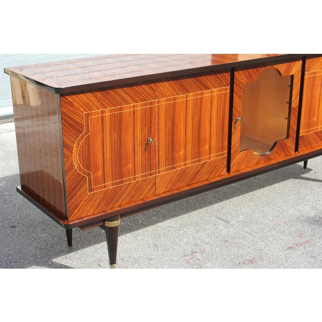 Beautiful long French Art Deco light exotic Macassar ebony sideboard/buffet bar circa 1940s. The sideboard are in very...