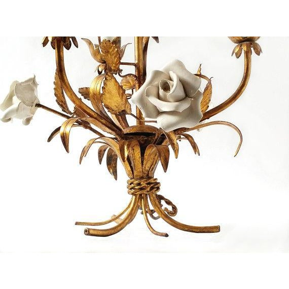 Gold tole three arm chandelier, French, 1920's. Gold leaves, stems and six white porcelain roses. Delicate capiz shell...