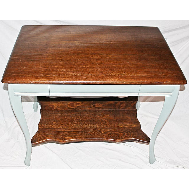 Handsome and practical. A solid oak 1890s American oak writing desk, single center drawer, lower storage shelf. Frame just...