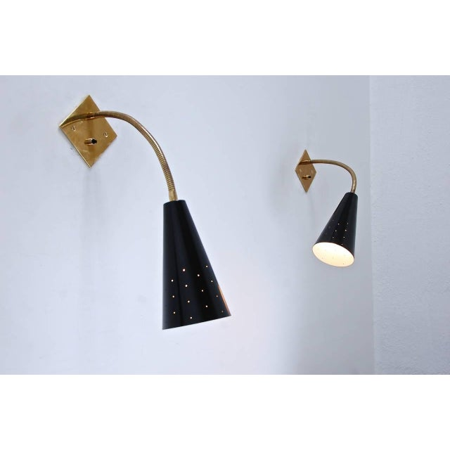 A pair of Classic black and brass gooseneck sconces in aged patina brass and painted aluminum. Inspired by 1950s Italian...