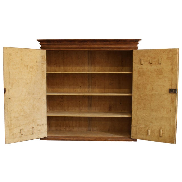 """A grand-scale 17th century Tuscan """"armadio"""" or armoire cabinet from a convent in Florence, having two raised panel doors,..."""