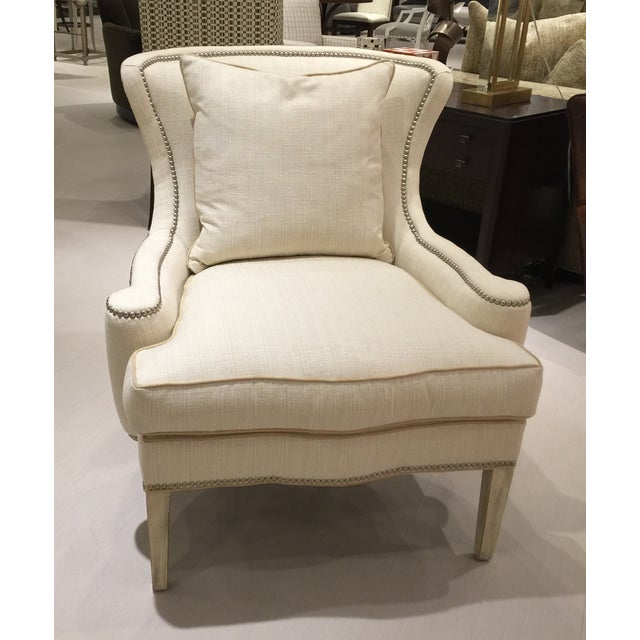 Southwood Furniture Transitional Modified Wing Chair. Has silver nail detail and contrast welting. Curved back chair.