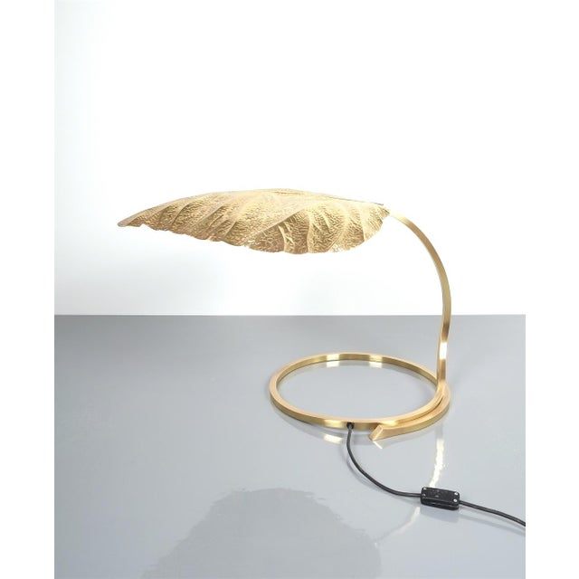 Excellent refurbished large table lights by Tomasso Barbi, Italy, 1970 featuring a giant hammered shiny brass rhubarb leaf...