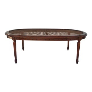 Antique Carved Wood and Cane Oval Coffee Table For Sale