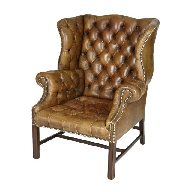 An Elegant Brown Tufted Leather and Mahogany Wing Chair with Tight Seat; English Circa 1860. For Sale