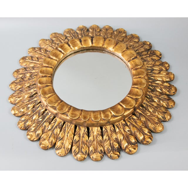 A stunning Mid-Century French giltwood sunburst mirror with lovely gilt patina and finely carved rays. It would make a...