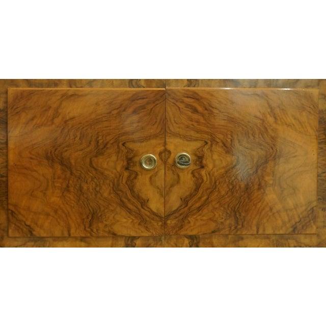 "Bold harlequin macassar ebony marquetry wraps this grand buffet. Contrasting mahogany and ormolu details. Width 87"", Depth..."