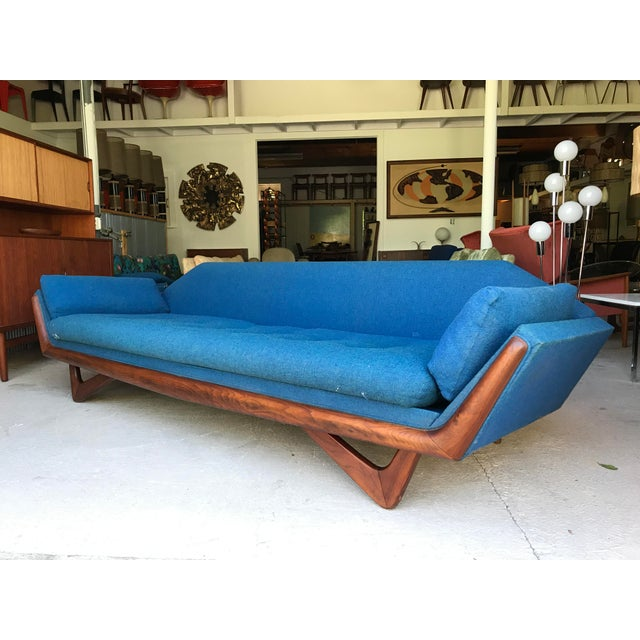 Arian Pearsall Craft Associates walnut gondola sofa. Sofa is in good vintage condition. Upholstery is original, has some...