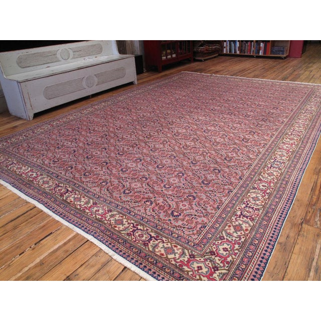 It is pink, but a very pretty pink. Lovely vintage Turkish carpet with a classical design, great patina, at great value.