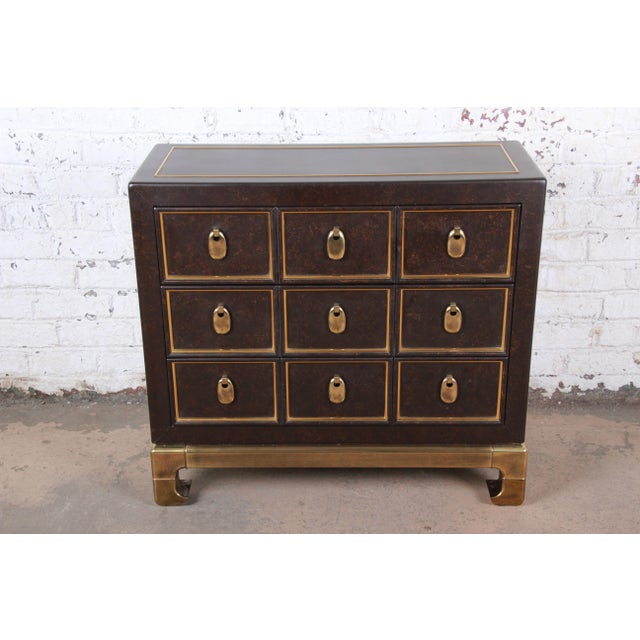 A rare and exceptional mid-century modern Hollywood Regency Chinoiserie three-drawer bachelor chest or commode By...