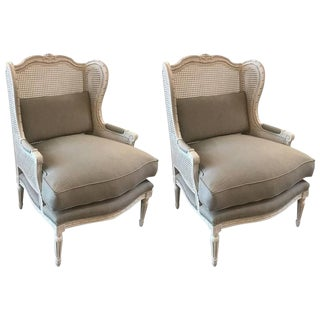 Stylish Pair of Louis XVI Style Painted Walnut and Cane Wing Chairs For Sale