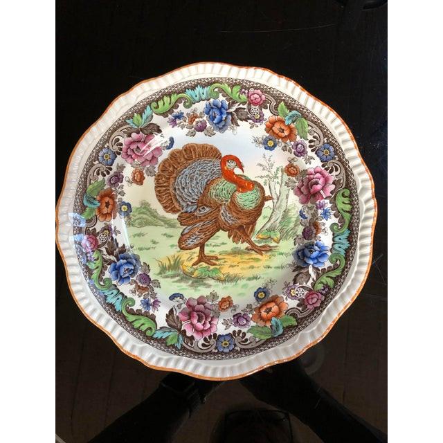 Classic strutting turkey adorns this beautiful scallop edge plate. Encircled by a garland of colorful fall flowers, this...