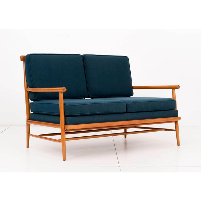 McCobb Windsor back settee Birchwood with spindle back, turned wood arms and legs. Paul McCobb was a Modern designer who...