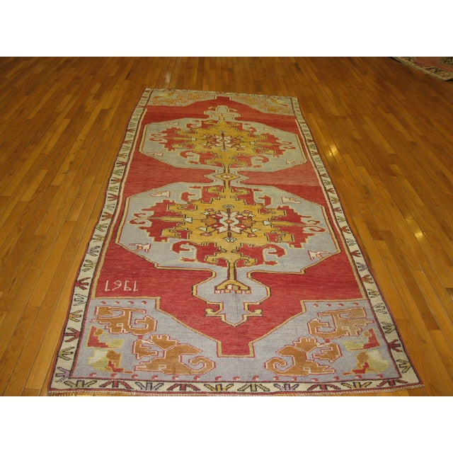 This is an exquisite hand knotted vintage wide hall rug that would bring life and character to any space specially a wide...