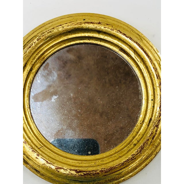 """5.5"""" Florentine wall mirror marked Italy."""