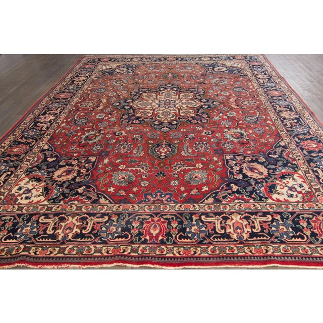 Vintage hand-knotted Persian rug with a medallion design on a red field. This rug has a great color scheme and is ready...