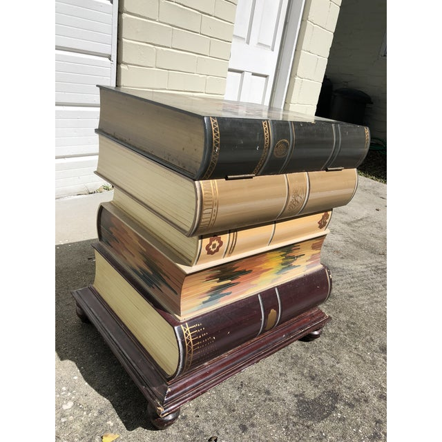 Vintage stack of books side table with storage, by Pulaski. The wear is consistent with age—the top has some damage and...