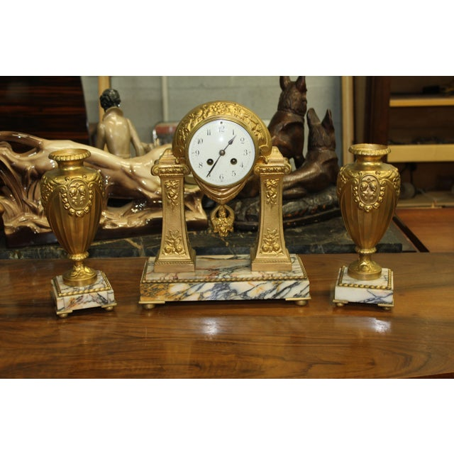 French art deco gilt metal clock garniture set, spectacular 3 piece set on marble base. Signed G Limousin france