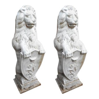 Cast Iron Lion Statues Holding a Shield - a Pair For Sale