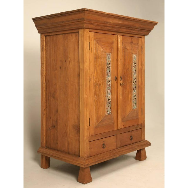 Vintage Indonesian armoire made from teakwood that a client of ours purchased as an antique, and since our knowledge is...