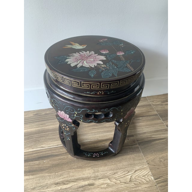 Vintage Chinoiserie stool or side table .Decorated in the Coromandel style (Chinese lacquerware) with pink flowers and...