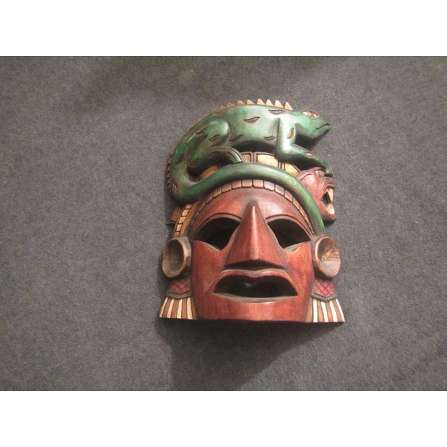 Bright and colorful! This Vintage Tiki Mask Sculpture will liven up almost any room! Wonderful edition to a bar, a den or...