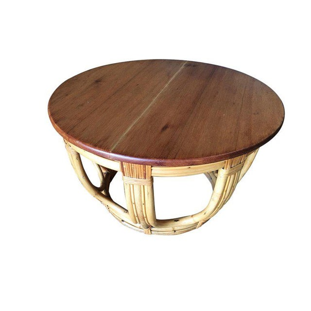 """Round steam bend pole rattan coffee table with """"Fancy Wrapping"""". This rattan table features a unique rounded steam bent..."""