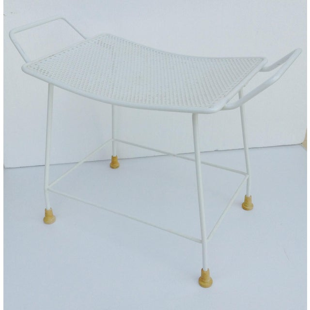 Vintage; 1950's-60's mid-century white enameled stool with perforated ben-day dot seat bottom. The seat has a seductively...