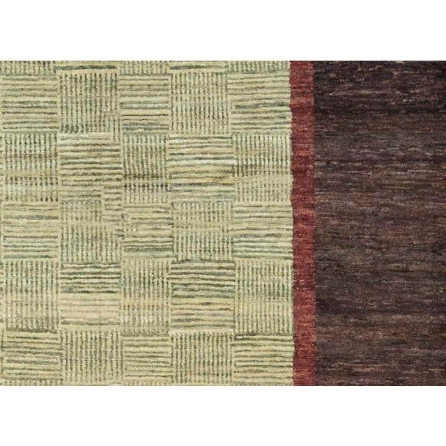 Classic Gabbeh designs have been given a contemporary update to create a line of genuine hand loomed wool rugs that will...