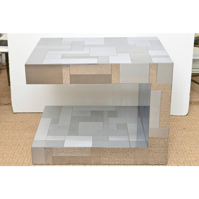 The mixed texture of polished vs. satin chrome in this cityscape patchwork table is signed Paul Evans for Directional on...