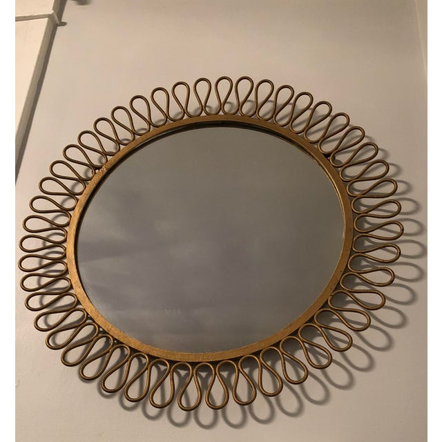 Round wall mirror in original gold finish by Maurizio Tempestini for John Salterini. Made in the mid 20th century.