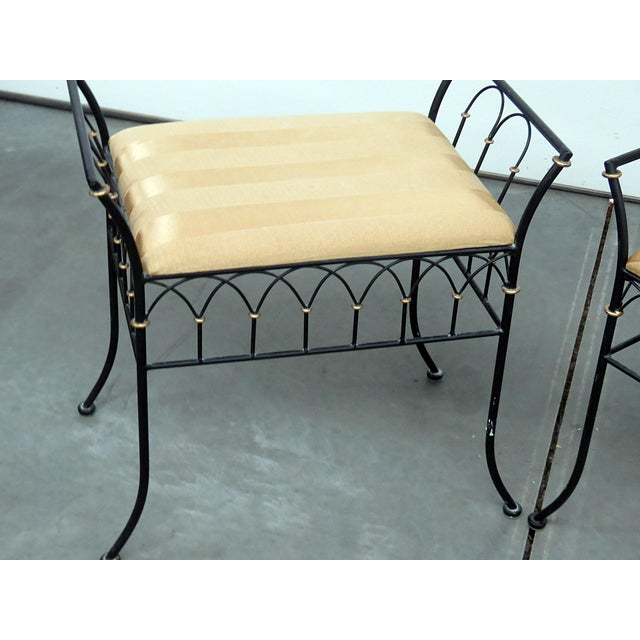 Pair of Directoire style benches with upholstered seats and gilt accents.