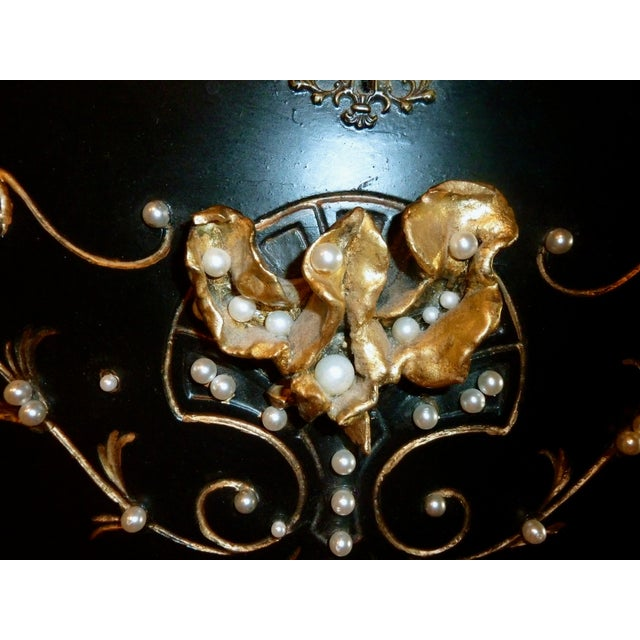 A one of a kind, secretary desk turned into a piece of ART. Ebony stain, gold leaf, pearls, and ceramic flower. This...