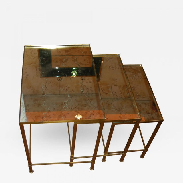 Set of 3 gold nest tables with mirror top.